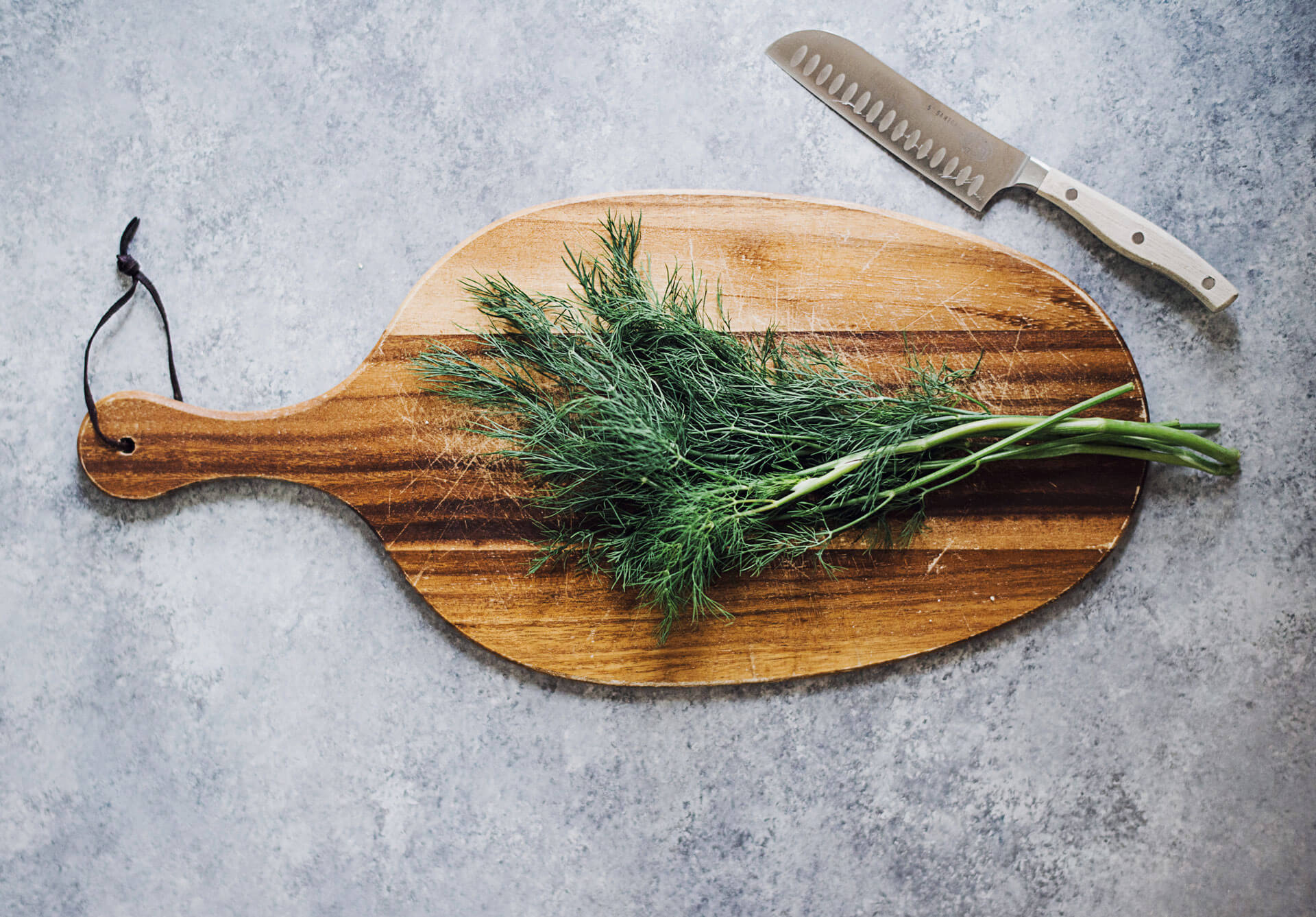 Herbs on chopboard